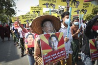 Protesters shout slogans and display images of deposed Myanmar leader Aung San Suu Kyi during an anti-coup protest march in Mandalay, Myanmar, on March 1, 2021. (AP Photo)