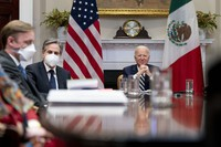 U.S. President Joe Biden, accompanied by White House national security adviser Jake Sullivan, left, and Secretary of State Antony Blinken, second from left, attends a virtual meeting with Mexican President Andres Manuel Lopez Obrador, in the Roosevelt Room of the White House on March 1, 2021, in Washington. (AP Photo/Andrew Harnik)