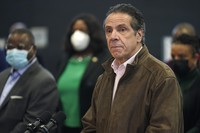 In this Feb. 22, 2021 photo, New York Gov. Andrew Cuomo, right, pauses to listen to a reporter's question during a news conference at a COVID-19 vaccination site in the Brooklyn borough of New York. (AP Photo/Seth Wenig, Pool)