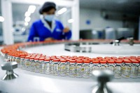 In this Dec. 23, 2020, file photo released by China's Xinhua News Agency, a Sinovac worker checks the labeling on vials of COVID-19 vaccines on a packaging line in Beijing. (Zhang Yuwei/Xinhua via AP)