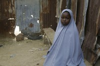 Student Amtallahi Lawal, 11, who hid under her bed and managed to escape when gunmen abducted more than 300 girls from her boarding school, recounts her ordeal at her house in Jangebe town, Zamfara state, northern Nigeria, on March 1, 2021. (AP Photo/Sunday Alamba)