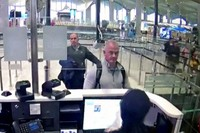 This Dec. 30, 2019, file image from security camera video shows Michael L. Taylor, center, and George-Antoine Zayek at passport control at Istanbul Airport in Turkey. Michael Taylor and his son Peter, suspected of helping former Nissan Chairman Carlos Ghosn skip bail and escape to Lebanon in December 2019 have been extradited to Japan. (DHA via AP)