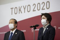 Tokyo 2020 Organizing Committee President Seiko Hashimoto, right, speaks to media after a video conference with the IOC executive board on Feb. 24, 2021, in Tokyo. (Takashi Aoyama/Pool Photo via AP)