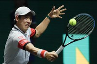 Japan's Kei Nishikori plays a shot against Canada's Felix Auger-Aliassime during their first-round men's singles match of the ABN AMRO world tennis tournament at Ahoy Arena in Rotterdam, Netherlands, on March 1, 2021. (AP Photo/Peter Dejong)