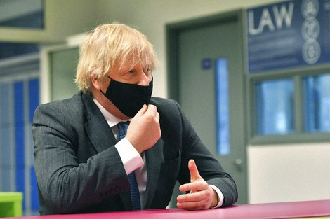 Britain's Prime Minister Boris Johnson meets sixth form students during a visit to Accrington Academy in Accrington, England, on Feb. 25, 2021 as they prepare for the return of all pupils on March 8. (Anthony Devlin/Pool Photo via AP)