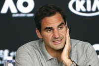 In this Jan. 30, 2020, file photo, Switzerland's Roger Federer speaks during a press conference following his semifinal loss to Serbia's Novak Djokovic at the Australian Open tennis championship in Melbourne, Australia. (AP Photo/Dita Alangkara)