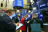 In this photo provided by the New York Stock Exchange, John Santiago, left, works with fellow traders on the floor on March 2, 2021, in New York. (Courtney Crow/New York Stock Exchange via AP)