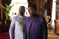 """Eddie Murphy, left, and Arsenio Hall appear in a scene from """"Coming 2 America."""" (Quantrell D. Colbert/Paramount Pictures via AP)"""