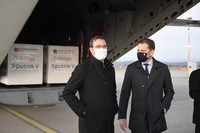 Slovak Prime Minister Igor Matovic, right, and Health Minister Marek Krajci are seen at Kosice Airport in Slovakia on March 1, 2021, as Russia's Sputnik V coronavirus vaccine arrives. (Frantisek Ivan/TASR via AP)