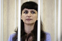 Belarusian journalist Katsiaryna Barysevich, seen in cage, attend a court hearing in Minsk, Belarus, on March 2, 2021. (Sergei Sheleg/BelTA Pool Photo via AP)