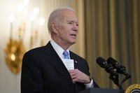 U.S. President Joe Biden speaks about efforts to combat COVID-19, in the State Dining Room of the White House on March 2, 2021, in Washington. (AP Photo/Evan Vucci)