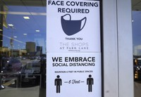 Signs tells customers about safety measures against COVID-19 that are required inside a retail store on March 2, 2021, in Dallas. (AP Photo/LM Otero)