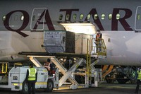 The first arrival of COVID-19 vaccines to Kenya is offloaded from a Qatar Airways flight at Jomo Kenyatta International Airport in Nairobi, Kenya, on March 3, 2021. (AP Photo)