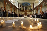 In this Nov. 7 2010, followers attend a mass at Our Lady of Salvation church in Baghdad, Iraq. (AP Photo/Khalid Mohammed)