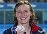 This July 27, 2019, file photo shows gold medalist United States' Katie Ledecky posing with her medal following the women's 800m freestyle final at the World Swimming Championships in Gwangju, South Korea. (AP Photo/Lee Jin-man)