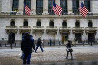 In this Feb. 16, 2021 file photo, pedestrians pass the New York Stock Exchange in New York. (AP Photo/Frank Franklin II)