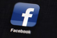This May 16, 2012 file photo shows the Facebook logo displayed on an iPad in Philadelphia. (AP)