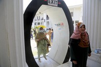 Lawmakers arrive to cast their vote in senate elections, at the provincial assembly, in Peshawar, Pakistan, on March 3, 2021. (AP Photo/Muhammad Sajjad)