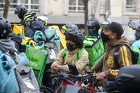 Delivery riders gather to protest outside the Spanish parliament in Madrid, on March 3, 2021. (AP Photo/Paul White)