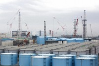 In this Feb. 23, 2017, file photo, storage tanks for contaminated water stand at the Fukushima Daiichi nuclear power plant of the Tokyo Electric Power Company (TEPCO) in Okuma, Fukushima Prefecture. (Tomohiro Ohsumi/Pool Photo via AP)