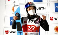 Japan's Sara Takanashi reacts on the podium after taking second place during the WSC Women's HS137 Large Hill jumping event at the FIS Nordic World Ski Championships in Oberstdorf, Germany, on March 3, 2021. (AP Photo/Matthias Schrader)
