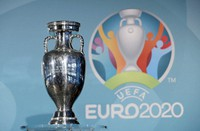 In this Oct. 27, 2016 file photo, the Euro soccer championships trophy is seen in front of the logo during the presentation of Munich's logo as one of the host cities of the Euro 2020 European soccer championships in Munich, Germany. (AP Photo/Matthias Schrader)