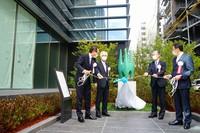 Hirogin Holdings Inc.'s President Toshio Heya, third from left, and others unveil a memorial in Naka Ward, Hiroshima, on March 2, 2021. (Mainichi/Akihiro Nakajima).