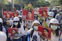 Protesters hold portraits of deposed Myanmar leader Aung San Suu Kyi during an anti-coup demonstration in Mandalay, Myanmar, on March 5, 2021. (AP Photo)