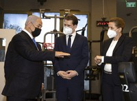 "Israeli Prime Minister Benjamin Netanyahu, left, visits a fitness gym with Austrian Chancellor Sebastian Kurz, center, and Danish Prime Minister Mette Frederiksen, to observe how the ""Green Pass,"" for citizens vaccinated against COVID-19, is used, in Modi'in, Israel, on March 4, 2021. (Avigail Uzi/Pool via AP)"