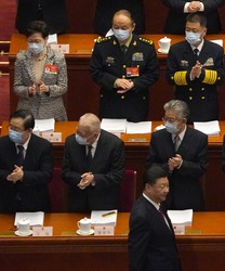 Hong Kong Chief Executive Carrie Lam, top left, and other delegates applaud as Chinese President Xi Jinping, bottom right, arrives for the opening session of China's National People's Congress (NPC) at the Great Hall of the People in Beijing, on March 5, 2021. (AP Photo/Andy Wong)