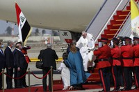 Pope Francis walks down the steps of an airplane as he arrives at Baghdad international airport, Iraq, on March 5, 2021. (AP Photo/Andrew Medichini)