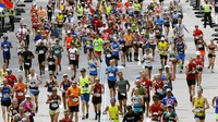 In this April 17, 2017, file photo, runners head down the stretch to the finish line in the 121st Boston Marathon in Boston. (AP Photo/Charles Krupa)