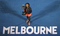 Japan's Naomi Osaka holds the Daphne Akhurst Memorial Cup after defeating the United States Jennifer Brady in the women's singles final at the Australian Open tennis championship in Melbourne, Australia, on Feb. 20, 2021.(AP Photo/Hamish Blair)