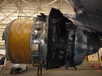 This photo provided by The National Transportation Safety Board shows the damaged engine of United Airlines Flight 328. (The National Transportation Safety Board via AP)
