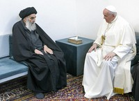 Pope Francis, right, meets with Iraq's leading Shiite cleric, Grand Ayatollah Ali al-Sistani in Najaf, Iraq, on March 6, 2021.  (AP Photo/Vatican Media)