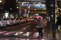 A man walks across an intersection towards a train station in Tokyo on March 5, 2021. (AP Photo/Hiro Komae)