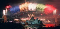 In this Oct. 1, 2000, file photo, the closing ceremony fireworks for the Sydney 2000 Olympic Games erupt over the Sydney Harbor Bridge and Opera House in Australia. (AP Photo/Steve Holland)