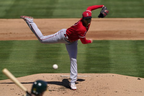 Los Angeles Angels pitcher Shohei Ohtani (17) throws against the Oakland Athletics during the first inning of a spring training baseball game, on March 5, 2021, in Mesa, Ariz. (AP Photo/Matt York)