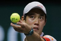 Japan's Kei Nishikori serves against Croatia's Borna Coric in their quarterfinal men's singles match of the ABN AMRO world tennis tournament at Ahoy Arena in Rotterdam, Netherlands, on March 5, 2021. (AP Photo/Peter Dejong)