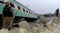 Army, police and rescue workers gather at the site of a derailed train in near Rohri, in southern Pakistan, Sunday, March 7, 2021. (AP Photo/Pervez Khan)