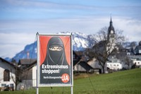 A poster supporting the initiative 'Yes to a ban on covering the face' is displayed at the village Buochs, Switzerland, Tuesday, Feb. 16, 2021. (Urs Flueeler/Keystone via AP)
