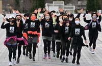 Participants in the White Ribbon Run charity event for women are seen running in matching T-shirts in Tokyo's Koto Ward, on March 7, 2021. (Mainichi/Takehiko Onishi)