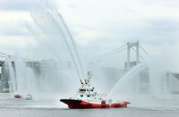 The Tokyo Fire Department's fireboat Oedo, foreground, and a Japan Coast Guard patrol vessel, among others, spray water simultaneously on March 7, 2021, in waters off Harumi Wharf in Chuo Ward, Tokyo. (Mainichi/Yoshinori Matsuda)