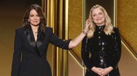 In this video grab issued Feb. 28, 2021, by NBC, hosts Tina Fey, left, from New York, and Amy Poehler, from Beverly Hills, Calif., speak at the Golden Globe Awards. (NBC via AP)