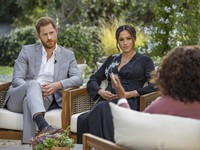 "This image provided by Harpo Productions shows Prince Harry, left, and Meghan, Duchess of Sussex, in conversation with Oprah Winfrey. ""Oprah with Meghan and Harry: A CBS Primetime Special"" airs March 7, 2021. (Joe Pugliese/Harpo Productions via AP)"