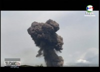 This TVGE image made from video shows smoke rising over the blast site at a military barracks in Bata, Equatorial Guinea, on March 7, 2021. (TVGE via AP)