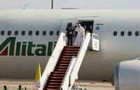 Pope Francis boards a plane upon concluding his visit to Iraq at Baghdad airport, Iraq, on March 8, 2021. (AP Photo/Khalid Mohammed)