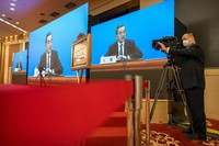 Chinese Foreign Minister Wang Yi speaks during a remote video press conference held on the sidelines of the annual meeting of China's National People's Congress (NPC) in Beijing, on March 7, 2021. (AP Photo/Mark Schiefelbein)