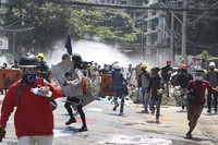 Protesters are dispersed as police fired tear gas during a demonstration in Yangon, Myanmar, on March 8, 2021. (AP Photo)