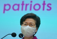 Hong Kong Chief Executive Carrie Lam listens to reporters' questions during a press conference in Hong Kong on March, 2021. (AP Photo/Vincent Yu)